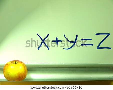 whiteboard of class room with an apple - stock photo