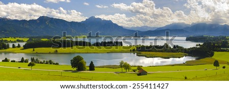 wide panorama landscape with alps mountains and lake Forggensee in Bavaria, Germany - stock photo