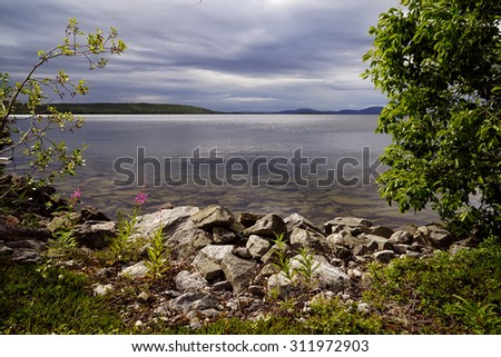 Wild nature of the North of Russia, beautiful lake            - stock photo