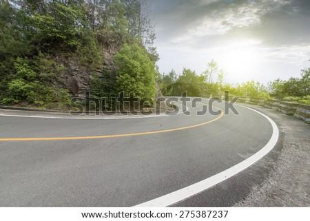 Winding road background - stock photo