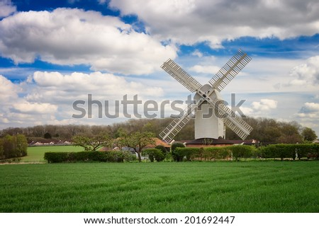 Windmill on a sunny day in the norfolk broads of england. - stock photo