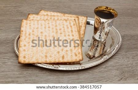 wine and matzoh jewish passover bread Passover matzo Passover wine - stock photo