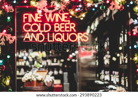 wine shop blurred of wine bottles  christmas Theme  vintage style - stock photo