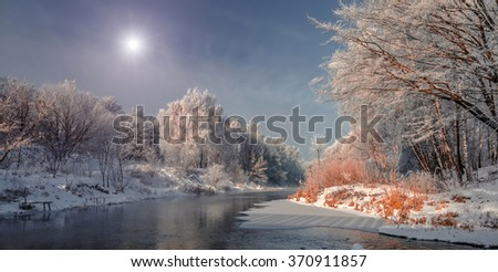 winter landscape. Frosty, misty morning on the small river. frost covered tree in the warm glow of sunrise on the beach. The beauty of the world.  Europe. Ukraine  frozen lake and trees in snow - stock photo