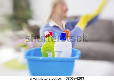 Woman from cleaning service prepare cleaning products for cleaning house - stock photo