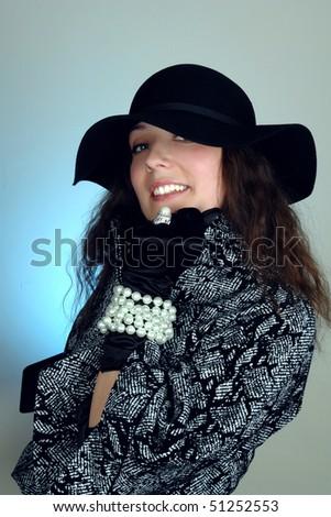 woman in black hat fashion portrait - stock photo