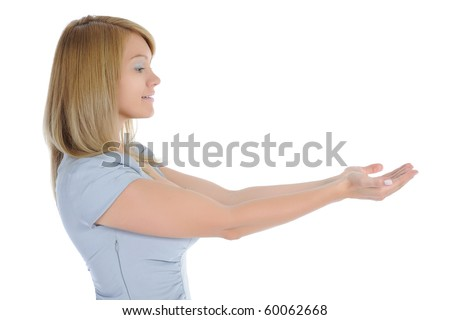 woman looks at her open palm. Isolated on white background - stock photo
