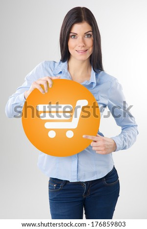 woman pointing to a orange ads board - stock photo