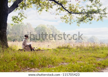 Woman Reading a Letter at the park - stock photo