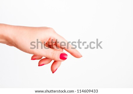 woman's hand shows the direction - stock photo