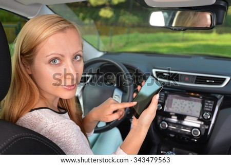 woman sit in modern  car in front of dashboard - stock photo