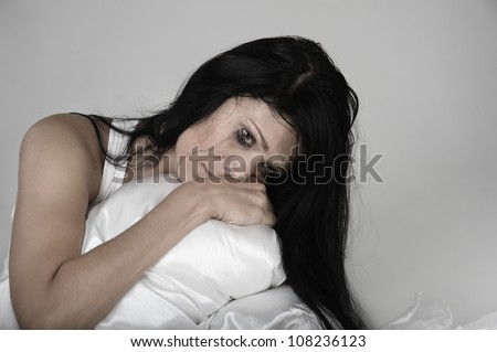 woman suffering from a severe depression - stock photo