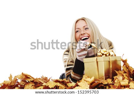 woman take autumn gift isolated in studio - stock photo