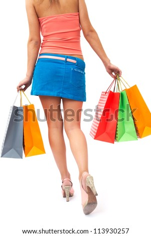woman with beautiful legs is shopping bags in hand - stock photo