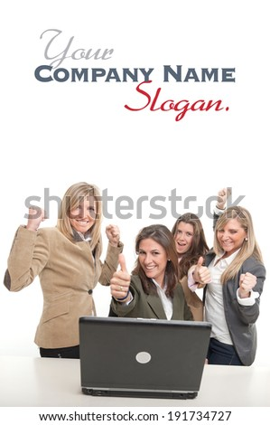 4 women around a desk with computer with winning gestures  - stock photo