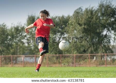 women kicking  ball - stock photo