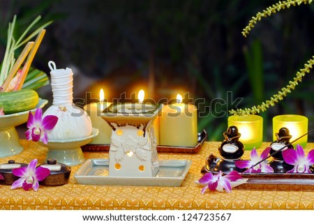 Women's hands are decorated with spa product Spa still life with heart herbal Thai ball. Spa still life with Thai herbal ball. - stock photo