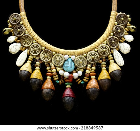 wood stone  necklace on black - stock photo