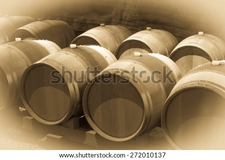 wooden barrels in french winery   cellar - stock photo