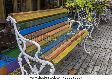 ��� Wooden bench in the autumn park close-up photo. Selective focus with shallow depth of field for the creative design of stage - stock photo