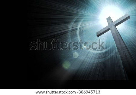 wooden cross on dark sky, abstract background - stock photo