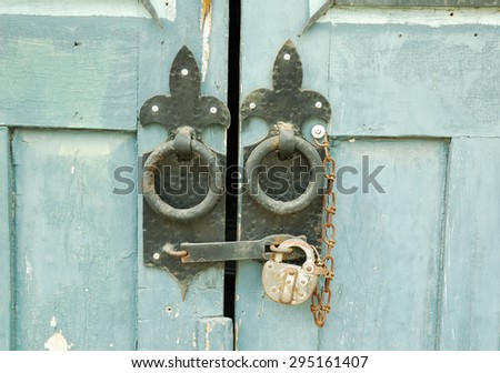 wooden door with lock - stock photo