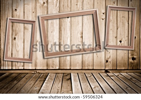 `wooden picture frame in the wooden room` - stock photo