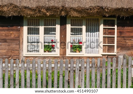wooden shutters windows in cottage - stock photo