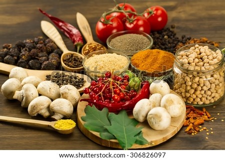Wooden table with colorful spices, herbs and vegetables.  Wooden table with colorful spices. Asian cuisine - stock photo