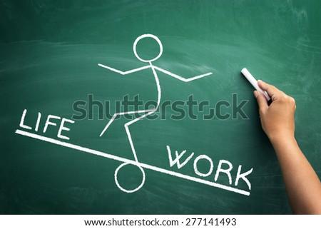 Work and life balance concept, funny handwriting sketch on blackboard - stock photo