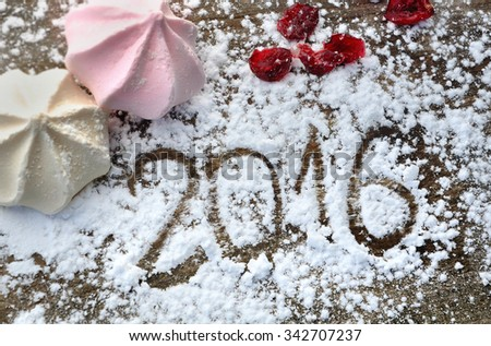 2016 writing in sugar with meringues on wooden plank - stock photo