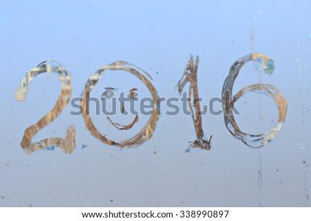 """""""2016"""" written on frosty winter window background - stock photo"""