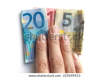 2015 written with euros bank notes in a hand isolated on white background - stock photo