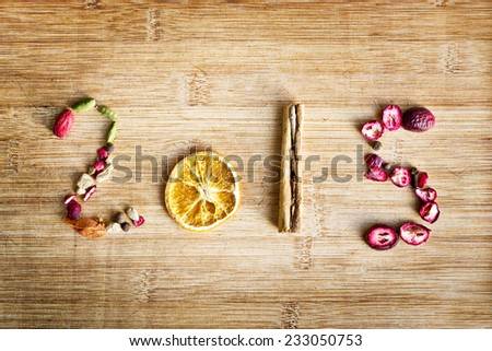 2015 written with spices on wooden background - stock photo
