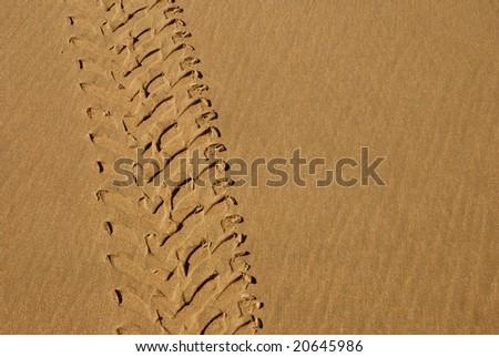 4x4 tracks on a sand - stock photo