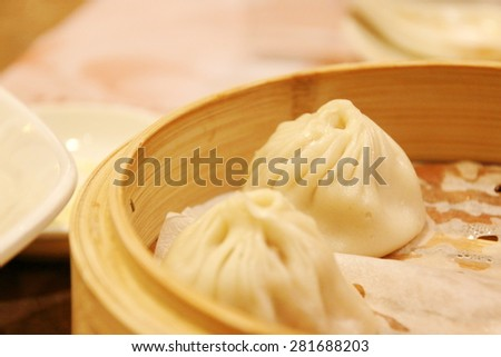 Xiao Long Bao, Chinese dim sum made by flour, pork and soup - stock photo