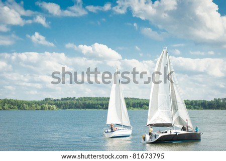 yachts on an anchor in harbor, boats series - stock photo