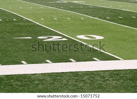 20 yard line markings on an artificial turf football field - stock photo