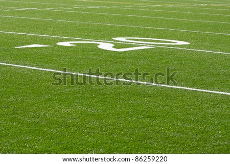 20 Yard Line of a Football Field with room for copy - stock photo