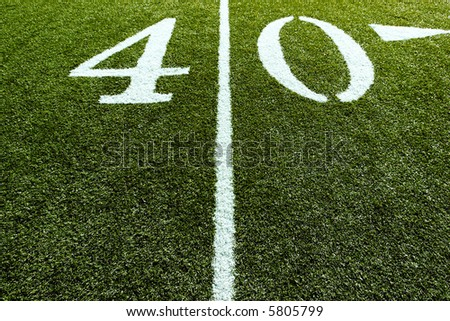 40 Yard Line with Line splitting the frame - stock photo