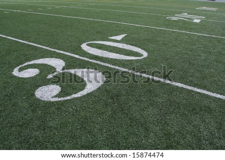 30 yard line with others in the distance - stock photo