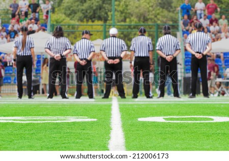 50 yards with blurred referees in the background. - stock photo