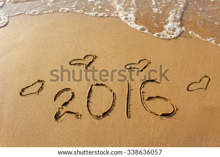 2016 year and heart written on sandy beach sea  - stock photo