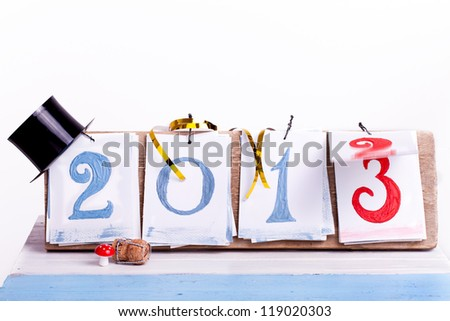 2013 year desk calendar with happy new year decoration, switching from year 2012 to year 2013, - stock photo
