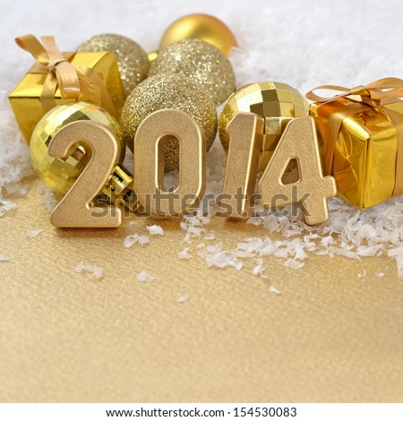 2014 year golden figures on the background of golden C�hristmas balls - stock photo