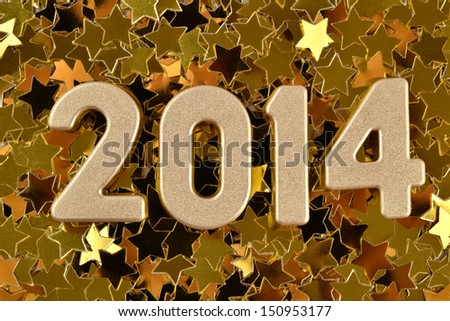 2014 year golden figures on the background of golden stars - stock photo