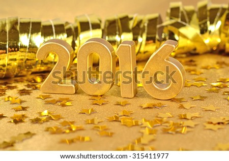2016 year golden figures on the background of golden stars. Selective focus. - stock photo
