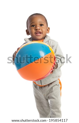 1 year old African American baby boy standing holding beach ball on isolated background - stock photo
