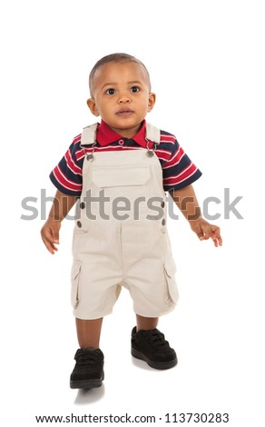 1-year old african american boy standing with curious expression looking at camera - stock photo