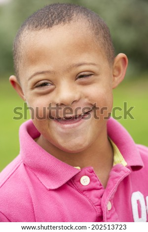 9 year old boy with Downs Syndrome - stock photo